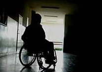 women in shadow in wheelchair