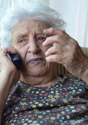 senior citizen at nursing home on phone
