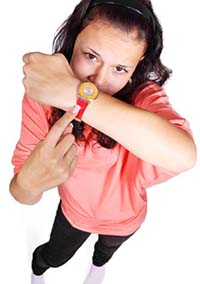 woman pointing to watch
